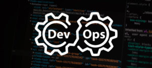 "a computer screen image with system codes and two gears with the word ""devops"" simulating their work"